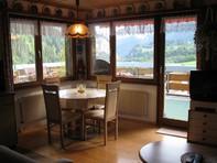 SANDRINA, Helle Attika Studiowohnung mit grosser Terrasse und Sauna im Haus